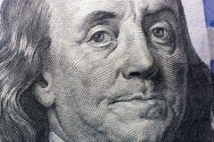 Κλείστε επάνω του προσώπου του Benjamin Franklin στο αμερικανικό δολάριο Στοκ Φωτογραφία