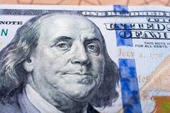 Κλείστε επάνω του προσώπου του Benjamin Franklin στο αμερικανικό δολάριο Στοκ Φωτογραφίες