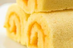 Κλείστε επάνω το κέικ ρόλων φετών, πορτοκαλί κέικ Στοκ Εικόνα