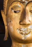 Κλείστε επάνω το μισό πρόσωπο του Βούδα στοκ εικόνες