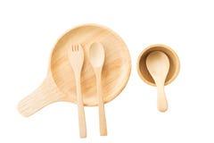 Κλείστε επάνω το ξύλινα πιάτο, το κουτάλι και το δίκρανο στο άσπρο υπόβαθρο Στοκ Φωτογραφία