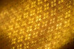 Κλείστε επάνω το χρυσό αφηρημένο υπόβαθρο υφάσματος Στοκ Φωτογραφίες