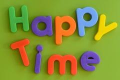 Κλείστε επάνω των ζωηρόχρωμων ευτυχών χρονικών λέξεων στο πλαστικό λ Στοκ Εικόνα