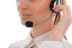Κλείστε επάνω των χειλιών επιχειρησιακών γυναικών με το ακουστικό και το μικρόφωνο που απομονώνονται στο άσπρο υπόβαθρο Στοκ εικόνα με δικαίωμα ελεύθερης χρήσης