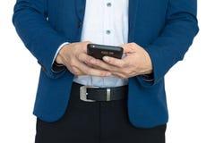 Κλείστε επάνω των χεριών με το έξυπνο τηλέφωνο Στοκ Εικόνες