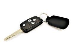 Κλειδί αυτοκινήτων με το ραδιόφωνο μακρινό και την ετικέττα δέρματος Στοκ εικόνα με δικαίωμα ελεύθερης χρήσης