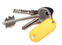 Κλειδί με την κενή χρυσή ετικέτα Στοκ φωτογραφία με δικαίωμα ελεύθερης χρήσης