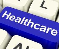 Κλειδί υγειονομικής περίθαλψης στο μπλε που παρουσιάζει σε απευθείας σύνδεση υγειονομική περίθαλψη Στοκ Φωτογραφίες