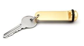 Κλειδί δωματίου ξενοδοχείου με τη χρυσή ετικέτα απεικόνιση αποθεμάτων