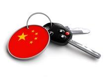 Κλειδιά αυτοκινήτων με τη σημαία της Κίνας ως μπρελόκ Στοκ Φωτογραφίες