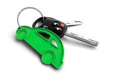 Κλειδιά αυτοκινήτων με το μπρελόκ εικονιδίων αυτοκινήτων Έννοια για την ιδιοκτησία ενός οχήματος Στοκ Φωτογραφία