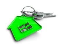 Κλειδιά σπιτιών με το μπρελόκ εγχώριων εικονιδίων Έννοια για την ιδιοκτησία ενός σπιτιού Στοκ εικόνες με δικαίωμα ελεύθερης χρήσης