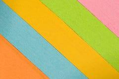 Κλιμένοι πολύχρωμοι σωροί του υποβάθρου εγγράφου Στοκ Εικόνα