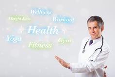 Κλινικός γιατρός που δείχνει τη συλλογή υγείας και ικανότητας του wor στοκ εικόνα με δικαίωμα ελεύθερης χρήσης