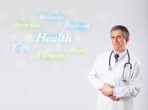 Κλινικός γιατρός που δείχνει τη συλλογή υγείας και ικανότητας του wor στοκ φωτογραφία με δικαίωμα ελεύθερης χρήσης