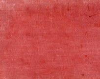 Κλωστοϋφαντουργικό προϊόν κόκκινου χρώματος surfacr με τα σημεία και τις γρατσουνιές Στοκ Φωτογραφία