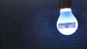 Λάμπα φωτός με μια επιχειρησιακή ιδέα σημαδιών απόθεμα βίντεο