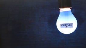 Λάμπα φωτός με το EUREKA λέξης απόθεμα βίντεο
