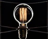 Λάμπα φωτός σε ένα μαύρο υπόβαθρο χρυσή σπείρα Στοκ Εικόνα