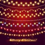 Λάμποντας γιρλάντες Φω'τα Χριστουγέννων για εορταστικό Στοκ Εικόνες