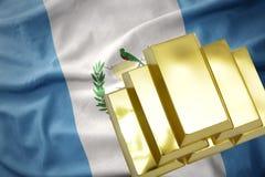 Λάμποντας χρυσές ράβδοι στη σημαία της Γουατεμάλα Στοκ Εικόνες