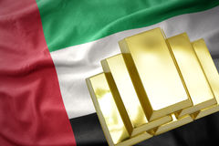 Λάμποντας χρυσές ράβδοι στη σημαία των Ηνωμένων Αραβικών Εμιράτων Στοκ Εικόνες
