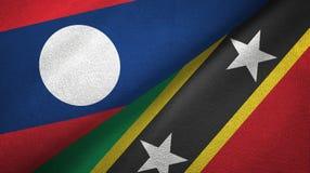 Λάος και Σαιντ Κιτς και Νέβις δύο υφαντικό ύφασμα σημαιών, σύσταση υφάσματος απεικόνιση αποθεμάτων