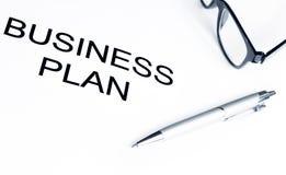 Λέξεις επιχειρηματικών σχεδίων κοντά στα γυαλιά και τη μάνδρα, επιχειρησιακή έννοια Στοκ Εικόνα