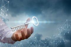 Λέξεις κλειδιά στο χέρι ενός επιχειρηματία στο δίκτυο υποβάθρου Στοκ φωτογραφία με δικαίωμα ελεύθερης χρήσης