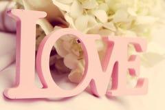 Λέξη αγάπης ως γαμήλια λεπτομέρεια Στοκ Φωτογραφίες