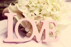 Λέξη αγάπης ως γαμήλια λεπτομέρεια Στοκ Εικόνες