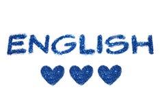 Λέξη αγγλικά και τρεις αφηρημένες καρδιές του μπλε ακτινοβολούν στο άσπρο υπόβαθρο Στοκ εικόνες με δικαίωμα ελεύθερης χρήσης