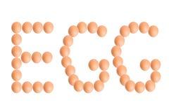 Λέξη ΑΥΓΩΝ από τα αυγά για τα τρόφιμα ή την έννοια διατροφής Στοκ εικόνα με δικαίωμα ελεύθερης χρήσης
