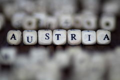 Λέξη ΑΥΣΤΡΙΑ σε ένα ξύλινο υπόβαθρο Στοκ φωτογραφίες με δικαίωμα ελεύθερης χρήσης