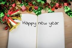 Λέξη καλής χρονιάς στο σημειωματάριο με τη νέα διακόσμηση έτους για νέα Στοκ φωτογραφία με δικαίωμα ελεύθερης χρήσης