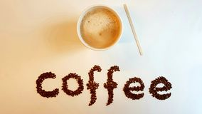 Λέξη με τα φασόλια καφέ Στοκ Εικόνες
