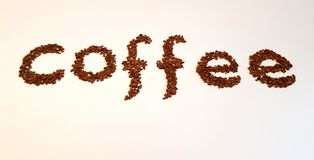 Λέξη με τα φασόλια καφέ Στοκ φωτογραφία με δικαίωμα ελεύθερης χρήσης