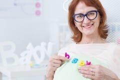 Λέξη μωρών στην κοιλιά Στοκ φωτογραφία με δικαίωμα ελεύθερης χρήσης