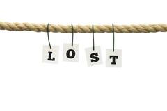 Λέξη - που χάνεται - που κρεμά από ένα σχοινί πέρα από το λευκό Στοκ Εικόνες
