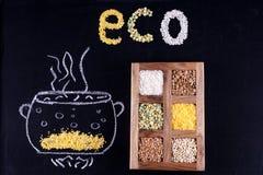 Λέξη ECO που αποτελείται από τους κόκκους στο μαύρο υπόβαθρο Στοκ Εικόνα