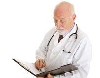λήψη σημειώσεων γιατρών Στοκ Εικόνες