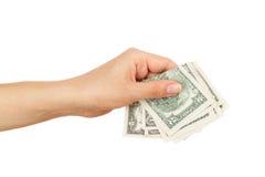 Λίγα δολάρια στο χέρι γυναικών ` s, που απομονώνεται Στοκ εικόνες με δικαίωμα ελεύθερης χρήσης