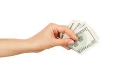 Λίγα δολάρια στο χέρι γυναικών ` s, που απομονώνεται Στοκ Εικόνες