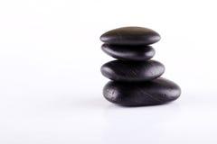 Λίγες μαύρες πέτρες λάβας που συσσωρεύονται ο ένας στον άλλο Στοκ εικόνες με δικαίωμα ελεύθερης χρήσης