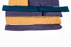 Λίγες τακτοποιημένες λουρίδες των υφασμάτων για το μαντίλι προσθηκών Στοκ Εικόνα