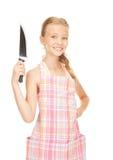Λίγη νοικοκυρά με το μαχαίρι Στοκ Φωτογραφίες