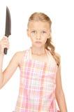 Λίγη νοικοκυρά με το μαχαίρι Στοκ φωτογραφίες με δικαίωμα ελεύθερης χρήσης