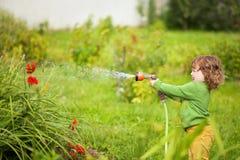 Λίγος αρωγός στον κήπο Στοκ φωτογραφία με δικαίωμα ελεύθερης χρήσης