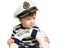 Λίγος ναυτικός κρατά lifebuoy Στοκ Εικόνα
