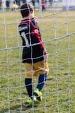 Λίγος τερματοφύλακας ποδοσφαίρου με τα γάντια Στοκ φωτογραφίες με δικαίωμα ελεύθερης χρήσης
